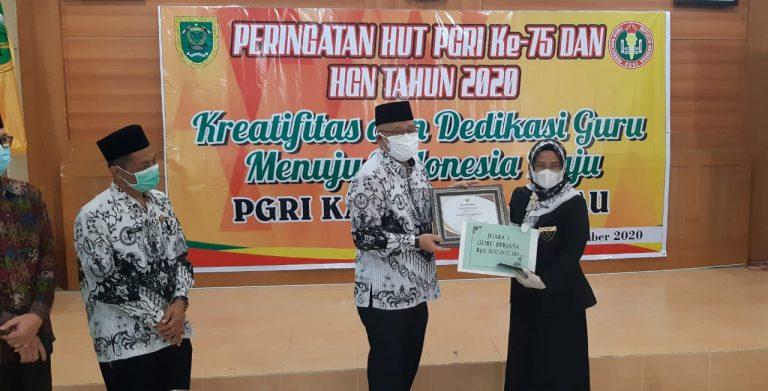 Guru Berjasa Karyani Tri Tialani, S.Pd.
